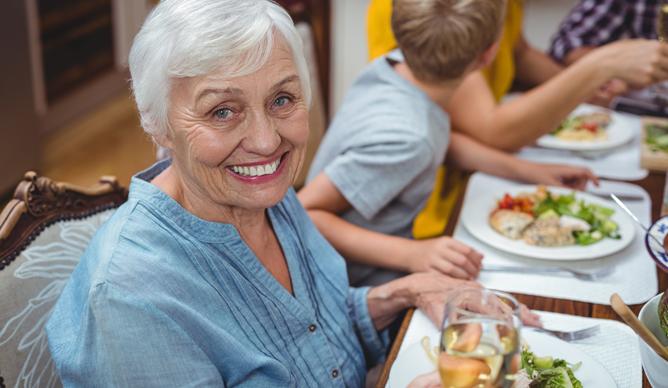 Elderly people having lunch
