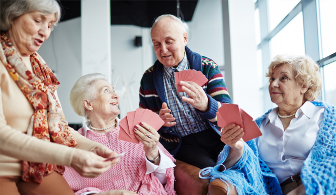 Elderly people playing cards