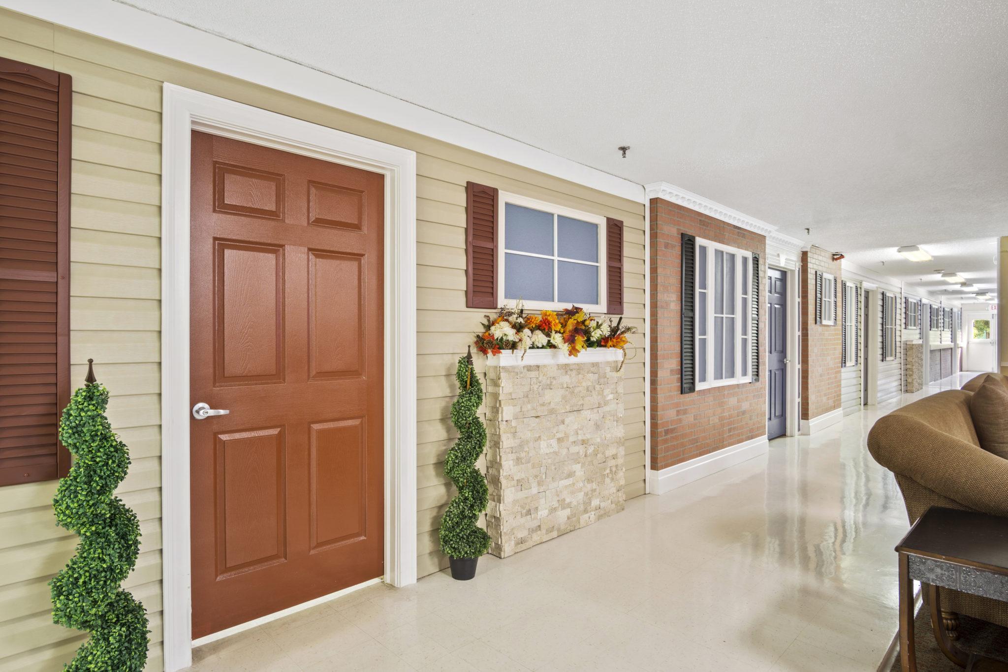 Hallway with doors and windows